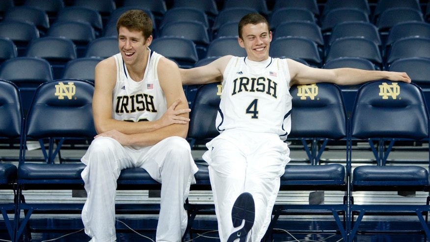 Notre Dame's Austin Burgett, left, and Patrick Crowley laugh during the NCAA college basketball team's media day on Wednesday, Oct. 9, 2013, in South Bend, Ind. (AP Photo/South Bend Tribune, James Brosher)