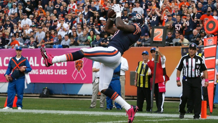 Chicago Bears wide receiver Alshon Jeffery (17) makes a touchdown reception in the end zone during the first half of an NFL football game against the New Orleans Saints, Sunday, Oct. 6, 2013, in Chicago.(AP Photo/Charles Rex Arbogast)
