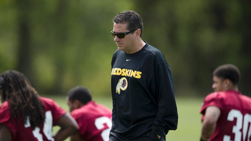 "In this photo taken May 5, 2013, Washington Redskins owner Dan Snyder walks by players during a rookie minicamp practice session at Redskins Park in Ashburn, Va. In an exclusive interview with the Associated Press conducted Friday, Oct. 4, 2013, Obama said he would ""think about changing"" the Washington Redskins' name if he owned the football team, wading into the controversy over a word many consider offensive to Native Americans. ""I don't know whether our attachment to a particular name should override the real legitimate concerns that people have about these things,"" he said, noting that Indians ""feel pretty strongly"" about mascots and team names that depict negative stereotypes about their heritage. Snyder has vowed to never abandon the name. (AP Photo/Evan Vucci)"