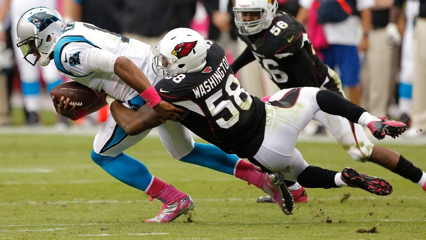 Carolina Panthers quarterback Cam Newton (1) is sacked by Arizona Cardinals linebacker Daryl Wawhington (58) during the second half of a NFL football game, Sunday, Oct. 6, 2013, in Glendale, Ariz. (AP Photo/Matt York)