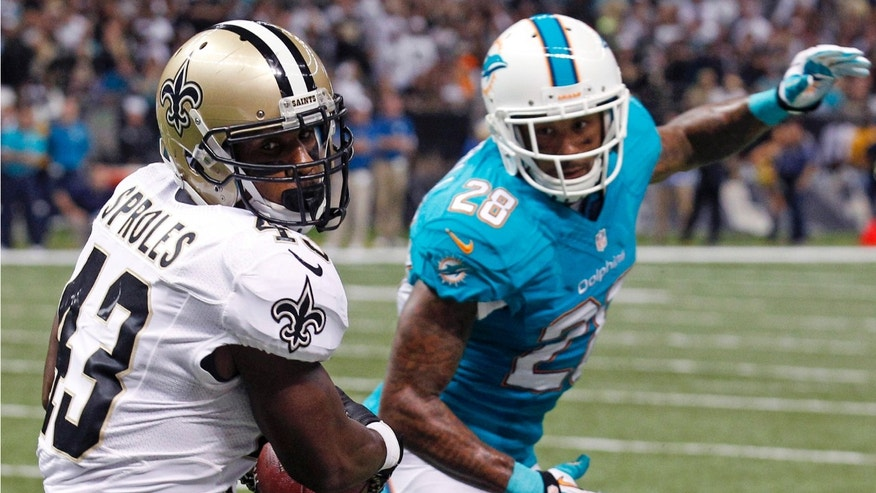 FILE - In this Sept. 30, 2013, file photo, New Orleans Saints running back Darren Sproles (43) pulls in a touchdown reception in front of Miami Dolphins cornerback Nolan Carroll (28) in the first half of an NFL football game in New Orleans. Combined, running backs Pierre Thomas and Darren Sproles have accounted for more yards and touchdowns receiving than rushing for the Saints.. AP Photo/Bill Haber, File)