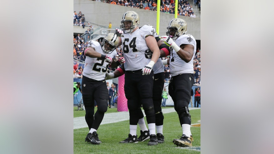 New Orleans Saints running back Pierre Thomas (23) celebrates his touchdown with his teammates during the first half of an NFL football game against the Chicago Bears, Sunday, Oct. 6, 2013, in Chicago.(AP Photo/Nam Y. Huh)