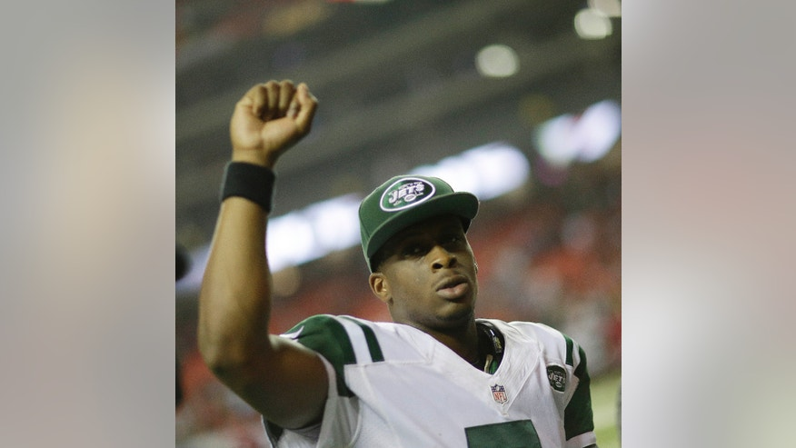 New York Jets quarterback Geno Smith celebrates after the second half of an NFL football game against the Atlanta Falcons, Monday, Oct. 7, 2013, in Atlanta. The New York Jets won 30-28. (AP Photo/David Goldman)