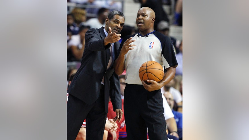 CORRECTS TO AUBURN HILLS, MICH. NOT DETROIT - Detroit Pistons coach Maurice Cheeks, left, argues a call with NBA official Olandis Poole in the first half of an NBA basketball preseason game on Thursday, Oct. 10, 2013, in Auburn Hills, Mich. (AP Photo/Duane Burleson)