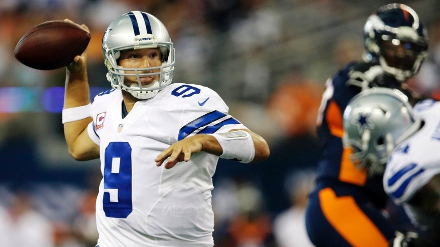 Dallas Cowboys quarterback Tony Romo rolls out to pass against the Denver Broncos during the fourth quarter of an NFL football game Sunday, Oct. 6, 2013, in Arlington, Texas. (AP Photo/Tony Gutierrez)