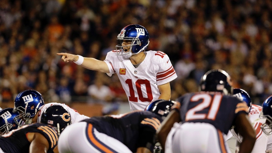 New York Giants quarterback Eli Manning (10) calls a play against the Chicago Bears in the first half of an NFL football game on Thursday, Oct. 10, 2013, in Chicago. (AP Photo/Nam Y. Huh)