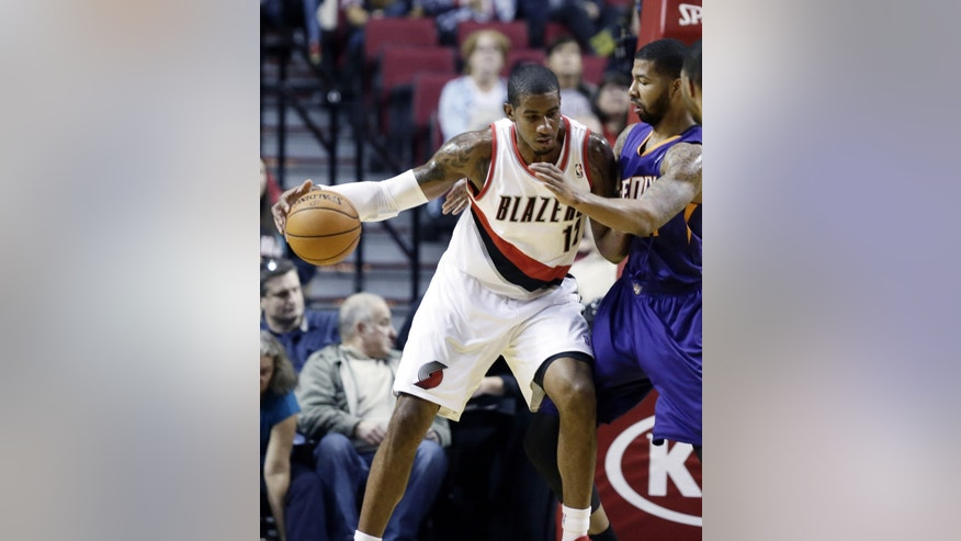 Portland Trail Blazers forward LaMarcus Aldridge, left, works the ball in against Phoenix Suns forward Markieff Morris during the first half of an NBA preseason basketball game in Portland, Ore., Wednesday, Oct. 9, 2013. (AP Photo/Don Ryan)