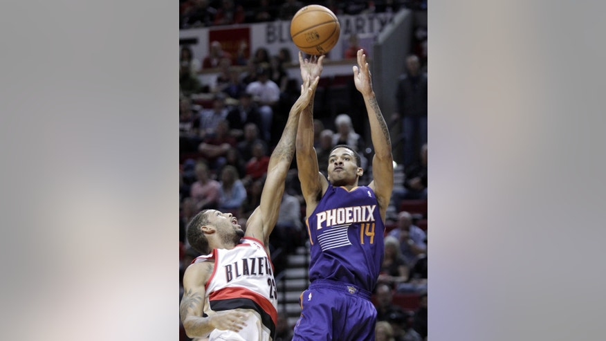 Phoenix Suns forward Gerald Green, right, shoots over Portland Trail Blazers forward Allen Crabbe during the first half of an NBA preseason basketball game in Portland, Ore., Wednesday, Oct. 9, 2013. (AP Photo/Don Ryan)