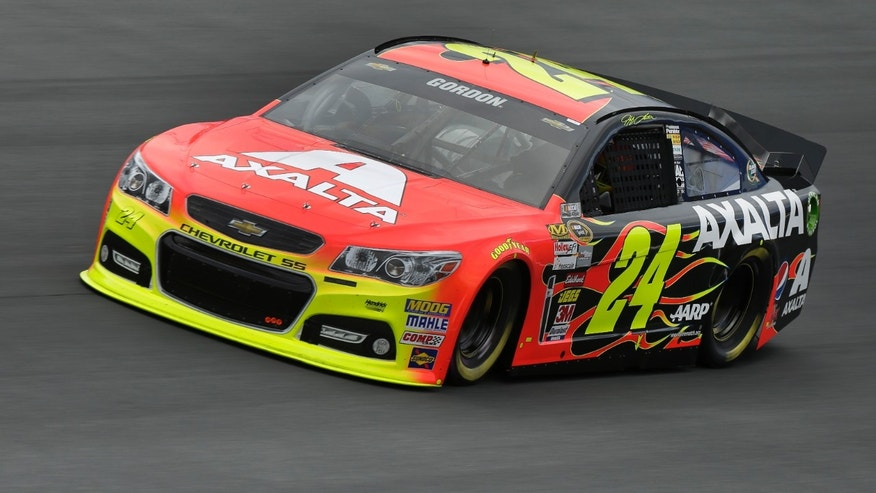 Jeff Gordon drives through Turn 4 during practice for Saturday's NASCAR Sprint Cup series auto race at Charlotte Motor Speedway in Concord, N.C., Thursday, Oct. 10, 2013. (AP Photo/Chuck Burton)