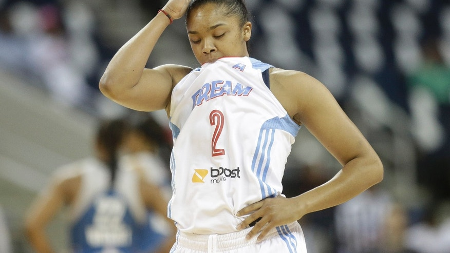 Atlanta Dream's Alex Brantley (2) walks down the court after play against the Minnesota Lynx during the first half of Game 3 of the WNBA Finals basketball game in Duluth, Ga., Thursday, Oct. 10, 2013. (AP Photo/John Bazemore)