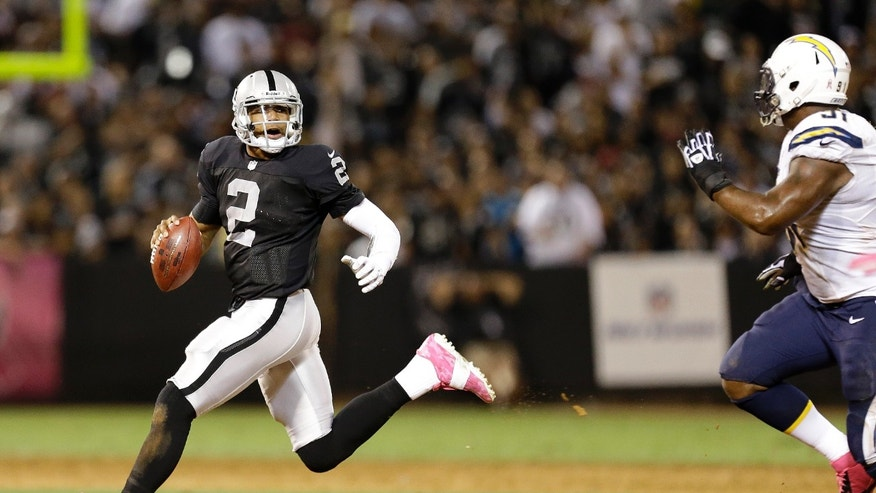 Oakland Raiders quarterback Terrelle Pryor (2) scrambles away from San Diego Chargers defensive end Kendall Reyes (91) during the second quarter of an NFL football game in Oakland, Calif., Sunday, Oct. 6, 2013. (AP Photo/Tony Avelar)