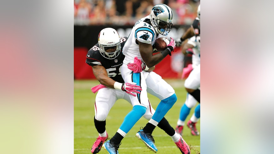 Carolina Panthers wide receiver Brandon LaFell (11) is tackled by Arizona Cardinals linebacker Daryl Washington (58) during the first half of a NFL football game, Sunday, Oct. 6, 2013, in Glendale, Ariz. (AP Photo/Matt York)