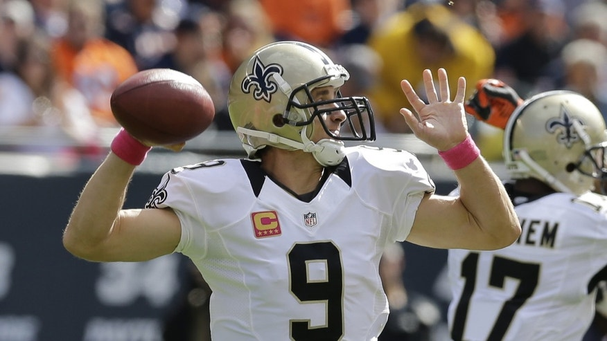 New Orleans Saints quarterback Drew Brees (9) throws a pass during the first half of an NFL football game against the Chicago Bears, Sunday, Oct. 6, 2013, in Chicago.(AP Photo/Nam Y. Huh)