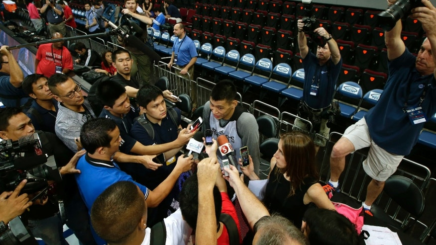 Houston Rockets' Jeremy Lin talks to the media following his team's practice Wednesday, Oct. 9, 2013, at the Mall of Asia Arena in Pasay city, south of Manila, Philippines. The Indiana Pacers will play against the Houston Rockets on Thursday in the first NBA game in this basketball-obsessed Southeast Asian nation, part of the NBA's global schedule that will have eight teams play in six countries this month. (AP Photo/Bullit Marquez)