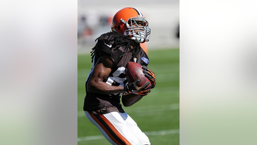 "In this photo taken on Wednesday, Oct. 9, 2013, Cleveland Browns' Travis Benjamin fields a punt during NFL football practice at the team's facility in Berea, Ohio. There's fast and then there's Benjamin, the Browns' fleet-footed punt returner who took one back 79 yards for a touchdown last week and earned his ""Rabbit"" nickname running down and catching the little critters as a kid in Florida. (AP Photo/Mark Duncan)"