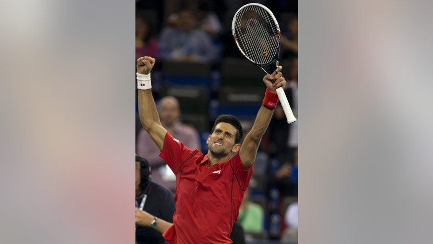 Serbia's Novak Djokovic celebrates after defeating France's Gael Monfils at their singles quarterfinal match of the Shanghai Masters tennis tournament at Qizhong Forest Sports City Tennis Center, in Shanghai, China, Friday, Oct. 11, 2013. Djokovic won 6-7, 6-2, 6-4. (AP Photo/Ng Han Guan)
