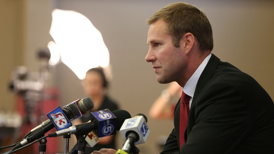 Iowa State coach Fred Hoiberg takes questions from the media during NCAA college basketball media day at the Sukup Basketball Complex in Ames, Iowa on Thursday, Oct. 10, 2013.  (AP Photo/The Des Moines Register, Charlie Litchfield)  NO SALES