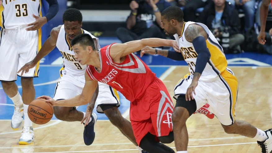 Jeremy Lin, center, of Houston Rockets runs past Indian Pacers, Solomon Hill, left, and C.J. Watson during their preseason game in Pasay, south of Manila, Philippines on Thursday, Oct. 10, 2013. Houston Rockets beat the Indiana Pacers 116-96 during the first NBA preseason game in the Philippines. (AP Photo/Aaron Favila)