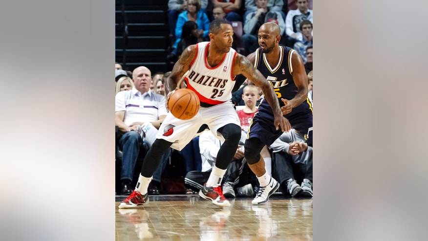 Portland Trail Blazers point guard Mo Williams (25) drives the ball against Utah Jazz point guard John Lucas III (5) in the first half of a preseason NBA basketball game on Friday, Oct. 11, 2013, in Boise, Idaho. (AP Photo/Otto Kitsinger)