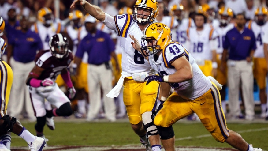 LSU quarterback Zach Mettenberger (8) throws a pass against Mississippi State as LSU fullback Connor Neighbors (43) goes past during the second half of an NCAA college football game in Starkville, Miss., Saturday, Oct. 5, 2013. No. 10 LSU won 59-26. (AP Photo/Rogelio V. Solis)