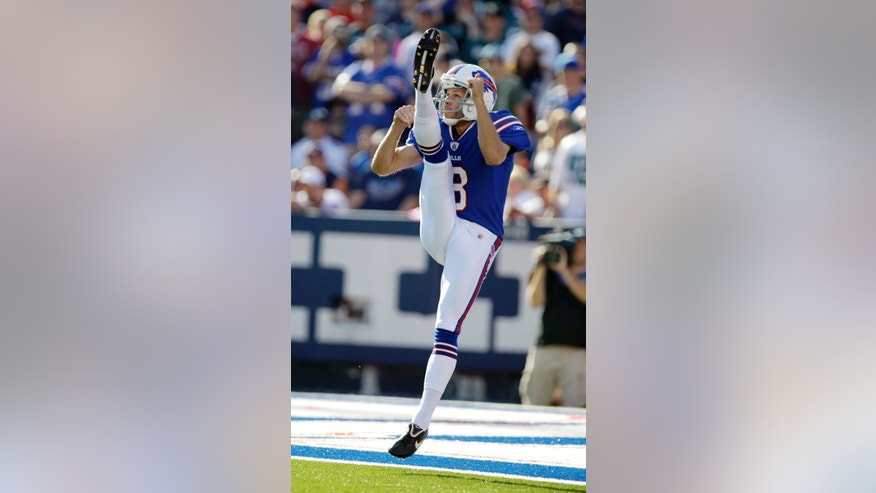 FILE - In this Oct. 9, 2011, file photo, Buffalo Bills punter Brian Moorman punts against the Philadelphia Eagles during the second half of an NFL football game in Orchard Park, N.Y. A year after being released by the Bills, Moorman is picking up where he left off with a team he spent his first 11-plus NFL seasons with after being re-signed last weekend.  (AP Photo/David Duprey, File)