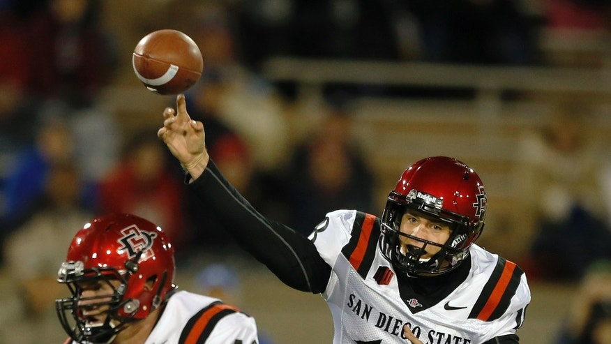 San Diego State quarterback Quinn Kaehler throws during the first quarter of an NCAA college football game against Air Force Academy, at the Air Force Academy, Colo. Thursday, Oct. 10, 2013. (AP Photo/Brennan Linsley)