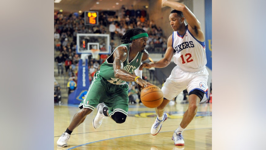 Boston Celtics forward Gerald Wallace (45) dribbles against Philadelphia 76ers Evan Turner (12) in the second quarter of a preseason NBA basketball game Friday, Oct 11, 2013, in Newark, Del. (AP Photo/Steve Ruark)