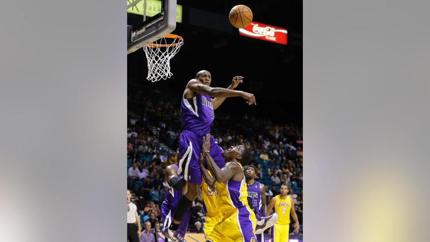 Sacramento Kings small forward Travis Outlaw (25) blocks a shot by Los Angeles Lakers shooting guard Darius Johnson-Odom (6) in the third quarter of a preseason NBA basketball game, Thursday, Oct. 10, 2013, in Las Vegas. (AP Photo/Julie Jacobson)