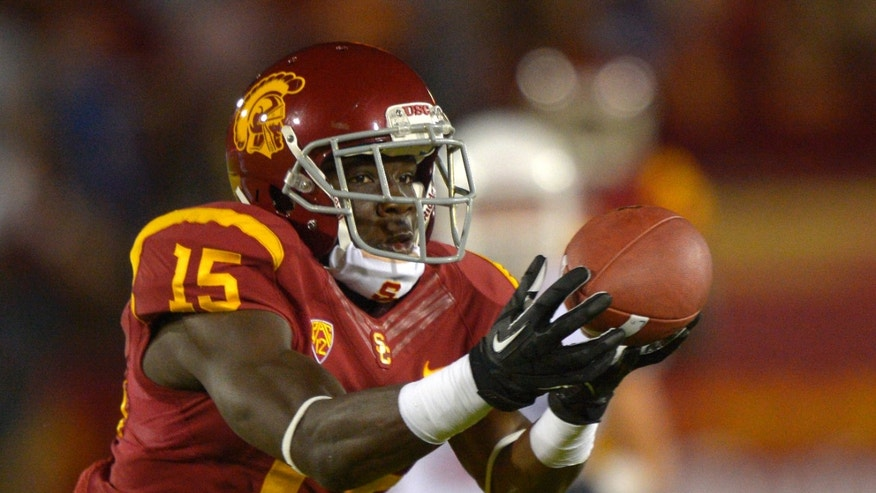 Southern California wide receiver Nelson Agholor catches a touchdown pass during the first half of an NCAA college football game against Arizona, Thursday, Oct. 10, 2013, in Los Angeles. (AP Photo/Mark J. Terrill)