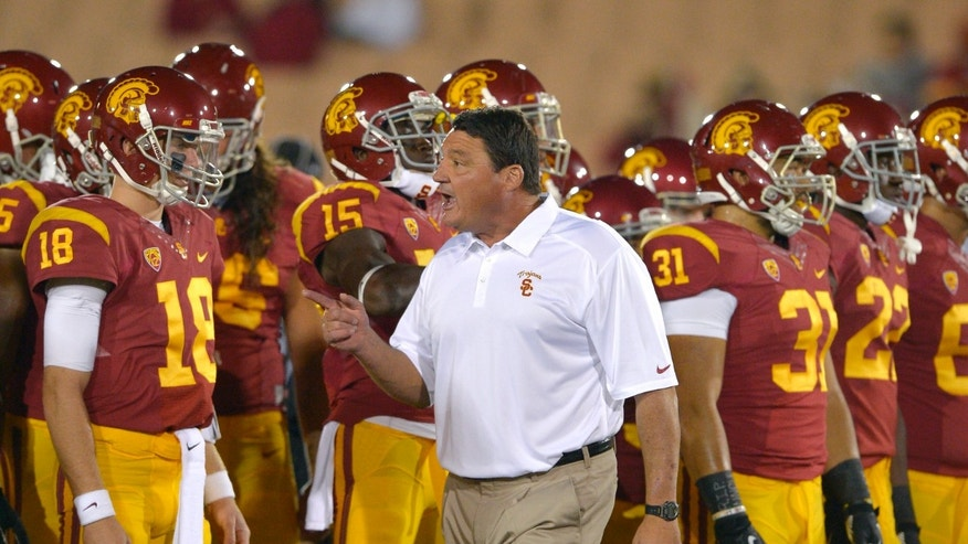 Southern California interim coach Ed Orgeron talks to his team prior to an NCAA college football game against Arizona, Thursday, Oct. 10, 2013, in Los Angeles. (AP Photo/Mark J. Terrill)