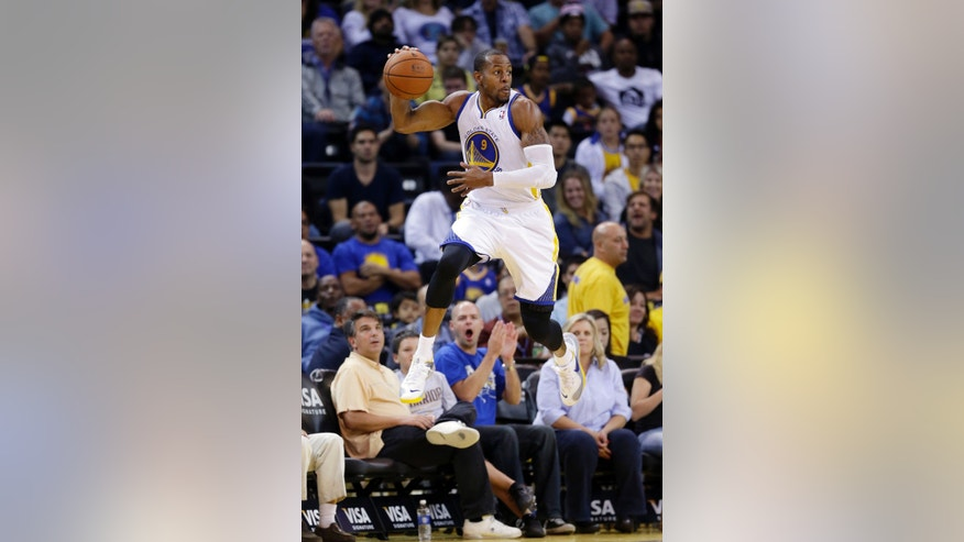 Golden State Warriors' Andre Iguodala saves the ball from going out of bounds against the Sacramento Kings during the second half of an NBA preseason basketball game Monday, Oct. 7, 2013, in Oakland, Calif. (AP Photo/Marcio Jose Sanchez)