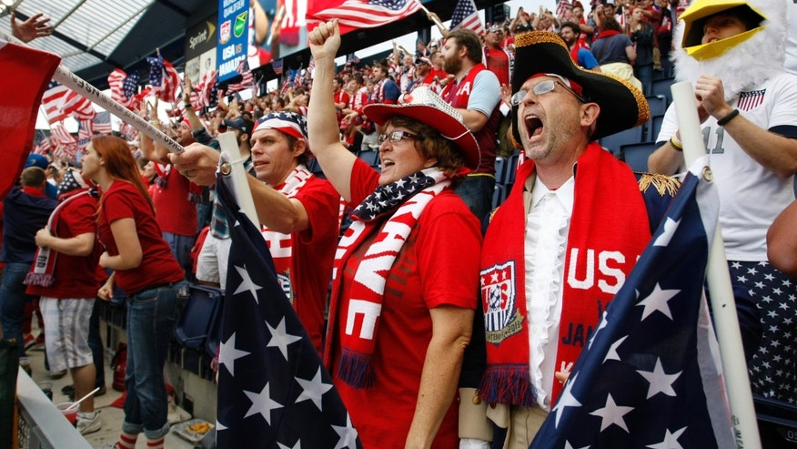 Fans wait for a World Cup qualifier soccer match between the United States and Jamaica at Sporting Park in Kansas City, Kan., Friday, Oct. 11, 2013. (AP Photo/Colin E. Braley)