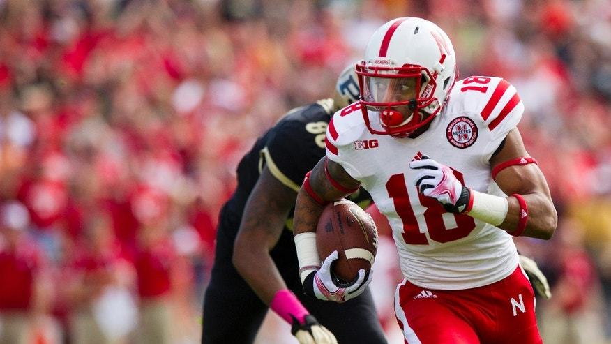 Nebraska's LeRoy Alexander (18) returns an interception against Purdue during the first half of an NCAA college football game, Saturday, Oct. 12, 2013, in West Lafayette, Ind. (AP Photo/Doug McSchooler)