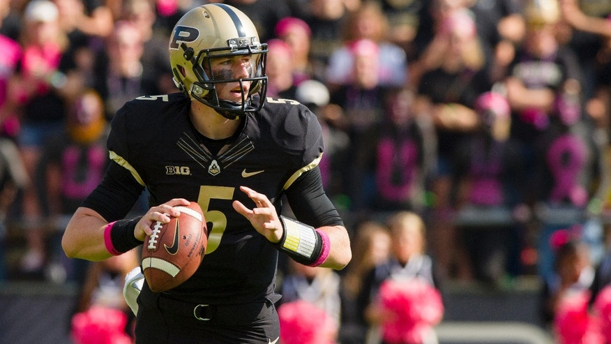 Purdue freshman quarterback Danny Etling (5) drops back to pass on the team's first play from scrimmage against Nebraska during the first half of an NCAA college football game, Saturday, Oct. 12, 2013, in West Lafayette, Ind. (AP Photo/Doug McSchooler)