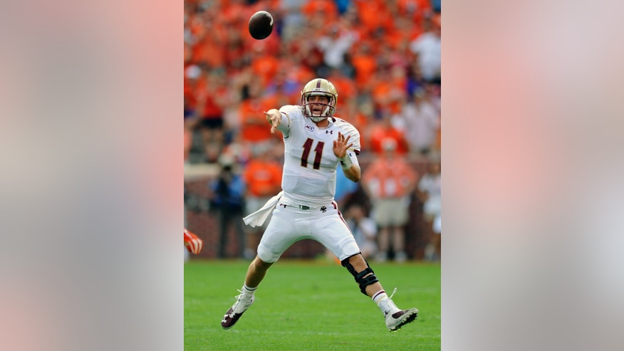 Boston College quarterback Chase Retting delivers a pass during the first half of an NCAA college football game against Clemson, Saturday, Oct. 12, 2013, in Clemson, S.C. (AP Photo/ Richard Shiro)
