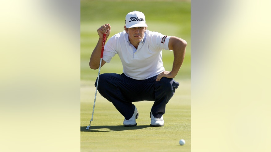 Brooks Koepka lines up his putt on the third hole during the third round of the Frys.com Open golf tournament, Saturday, Oct. 12, 2013, in San Martin, Calif. (AP Photo/Tony Avelar)