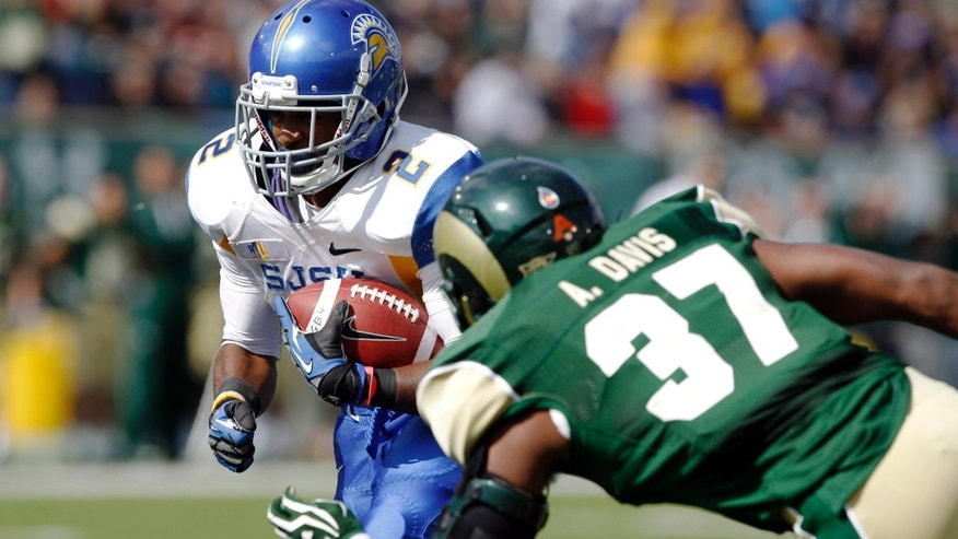 San Jose State wide receiver Tim Crawley, left, pulls in a pass before being hit by Colorado State linebacker Aaron Davis in the first quarter of an NCAA college football game in Fort Collins, Colo., on Saturday, Oct. 12, 2013. (AP Photo/David Zalubowski)