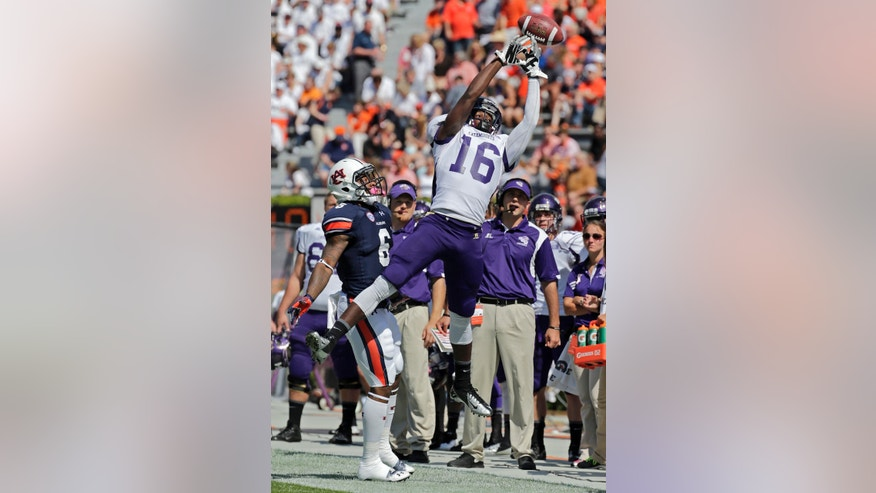 Western Carolina wide receiver Terryon Robinson (16) misses a catch as Auburn defensive back Jonathon Mincy (6) defends during the first half of an NCAA college football game in Auburn, Ala., Saturday, Oct. 12, 2013. (AP Photo/Dave Martin)