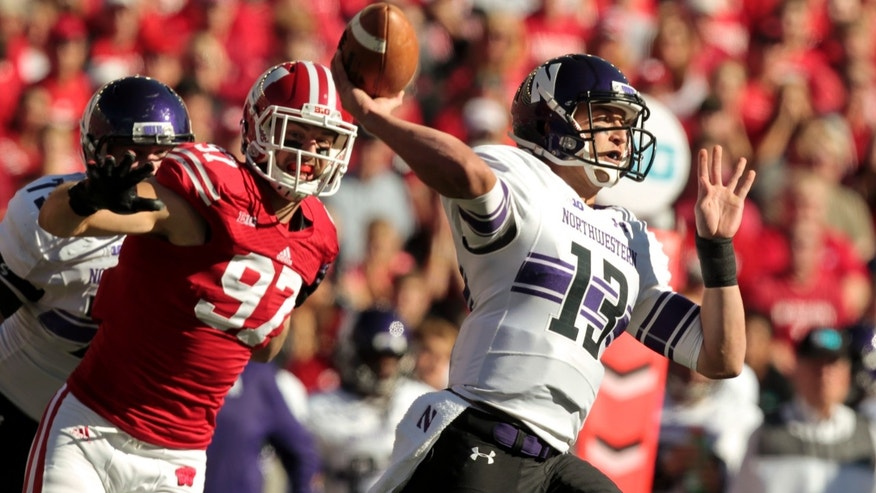 Wisconsin linebacker Brendan Kelly rushes Northwestern quarterback Trevor Siemian during the first half of an NCAA college football game in Madison, Wis., Saturday, Oct. 12, 2013. (AP Photo/Andy Manis)