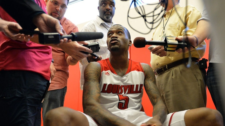 Louisville's Kevin Ware speaks with reporters during NCAA college basketball media day, Saturday, Oct. 12, 2013, in Louisville, Ky. (AP Photo/Timothy D. Easley)