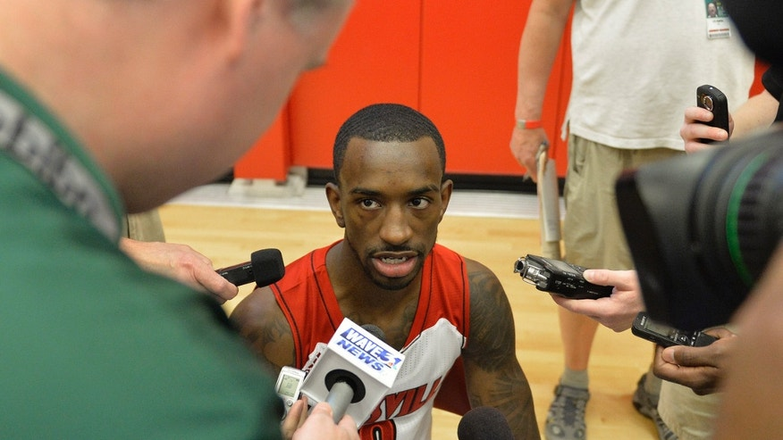 Louisville's Russ Smith answers questions from the media during NCAA college basketball media day, Saturday, Oct. 12, 2013, in Louisville, Ky. (AP Photo/Timothy D. Easley)