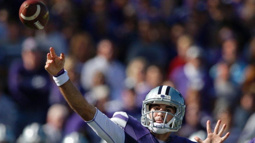 Kansas State quarterback Jake Waters throws a pass during the first half of an NCAA college football game against Baylor in Manhattan, Kan., Saturday, Oct. 12, 2013. (AP Photo/Orlin Wagner)