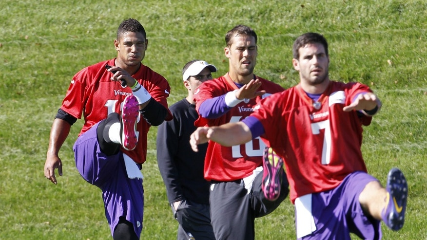 Minnesota Vikings quarterbacks Josh Freeman, left, Matt Cassell, center, and Christian Ponder, right, practice at Winter Park in Eden Prairie, Minn., Wednesday, Oct. 9, 2013. Freeman practiced with the Vikings for the first time since being claimed off waivers with the hopes of starting sooner rather than later. (AP Photo/Ann Heisenfelt)