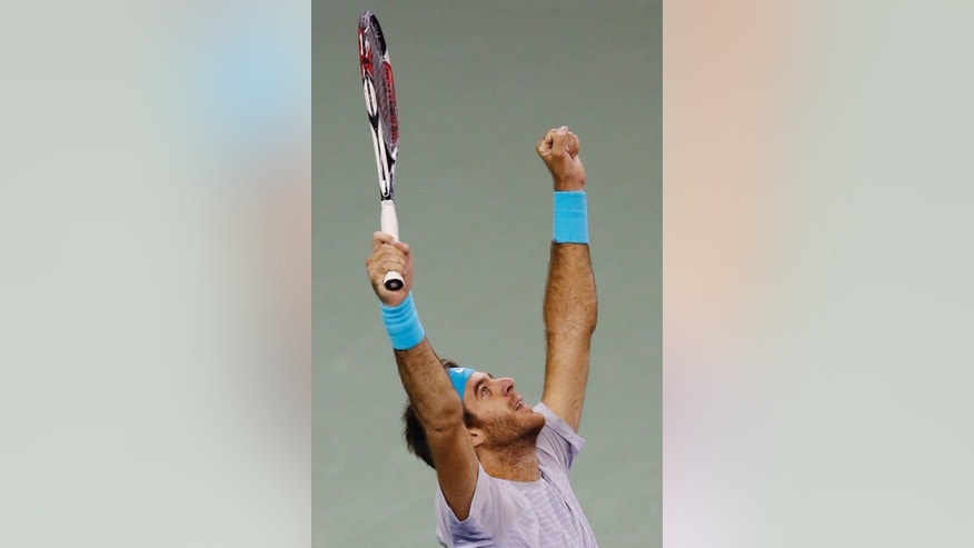 Juan Martin del Potro of Argentina celebrates after defeating Rafael Nadal of Spain during their singles semifinal match of the Shanghai Masters tennis tournament at Qizhong Forest Sports City Tennis Center, in Shanghai, China, Saturday, Oct. 12, 2013. Del Potro won 6-2, 6-4. (AP Photo/Eugene Hoshiko)