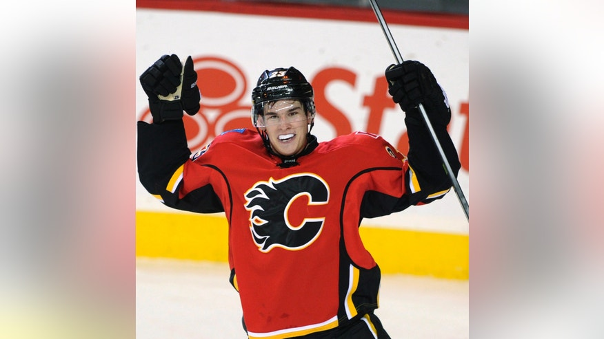 Calgary Flames' Sean Monahan celebrates scoring the go-ahead goal against the New Jersey Devils during the third period of an NHL hockey game Friday, Oct. 11, 2013, in Calgary, Alberta. The Flames won 3-2. (AP Photo/The Canadian Press, Larry MacDougal)