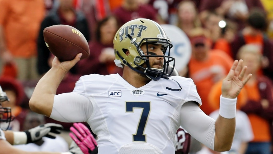 Pittsburgh quarterback Tom Savage (7) tosses a pass during the first half of an NCAA college football game against Virgina Tech in Blacksburg, Va., Saturday, Oct. 12, 2013.  (AP Photo/Steve Helber)