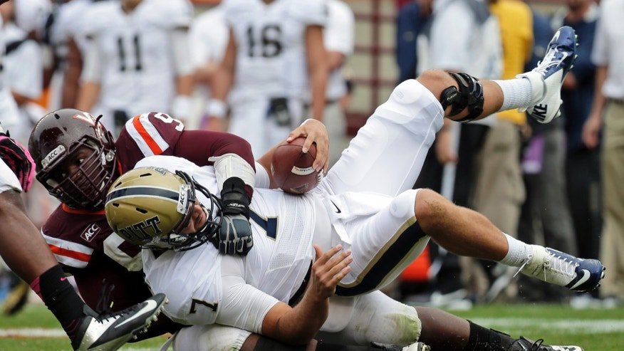 Pittsburgh quarterback Tom Savage (7) is sacked by Virginia Tech defensive tackle Derrick Hopkins (98) during the first half of an NCAA college football game in Blacksburg, Va., Saturday, Oct. 12, 2013.  (AP Photo/Steve Helber)