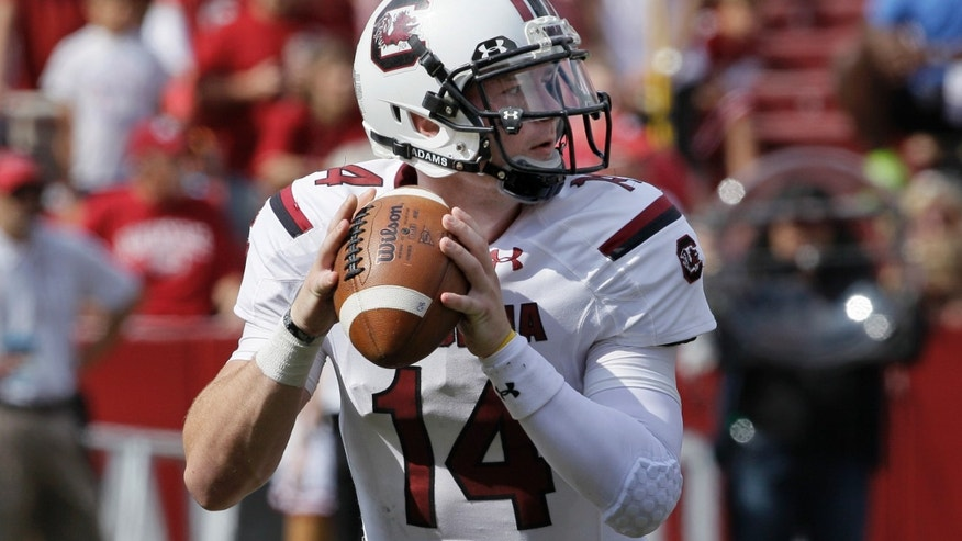 South Carolina quarterback Connor Shaw passes against Arkansas during the second quarter of an NCAA college football game in Fayetteville, Ark., Saturday, Oct. 12, 2013. (AP Photo/Danny Johnston)