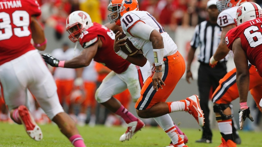 Syracuse quarterback Terrel Hunt (10) scrambles for a first down during the first half against North Carolina State in an NCAA college football game Saturday, Oct. 12, 2013, at Carter-Finley Stadium in Raleigh, N.C. (AP Photo/The News & Observer,  Ethan Hyman) MANDATORY CREDIT