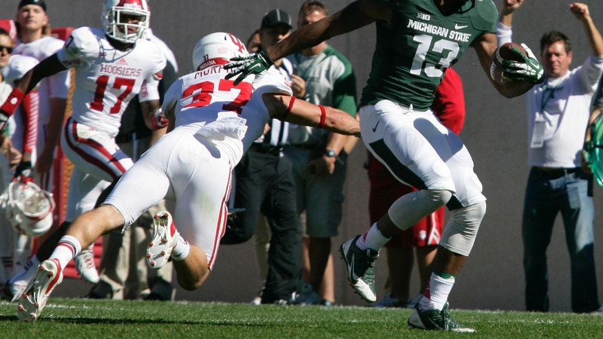 Michigan State's Bennie Fowler (13) gets past Indiana's Mark Murphy (37) and Michael Hunter (17) for a 34-yard touchdown on a pass reception during the second quarter of an NCAA college football game, Saturday, Oct. 12, 2013, in East Lansing, Mich. (AP Photo/Al Goldis)